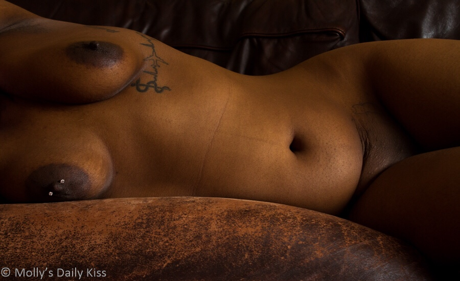 Cara lying on a couch naked in post titled Odalisque