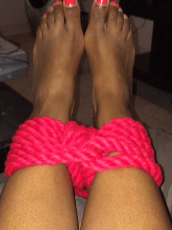 Red rope tied around Cara's ankles