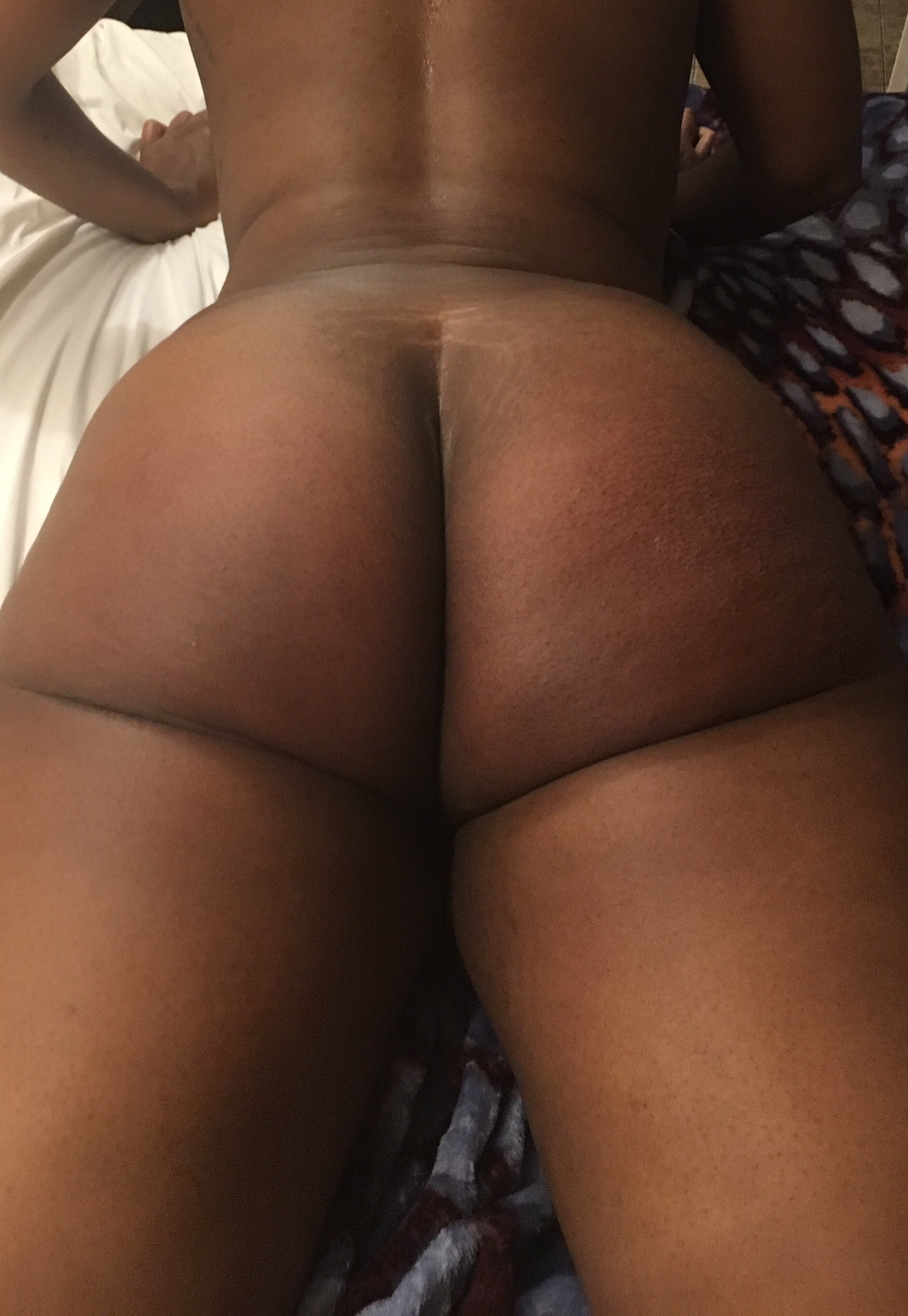 Cara, naked, lying down on a bed, bottom a little swollen after a spanking in post titled Everybody Poops