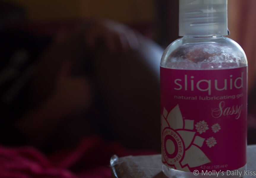 Sliquid in the foreground, Cara with Daddy's fingers in her cunt in the background in post titled A Hint