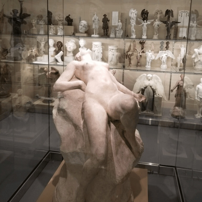 A marble statue of a naked woman lying back