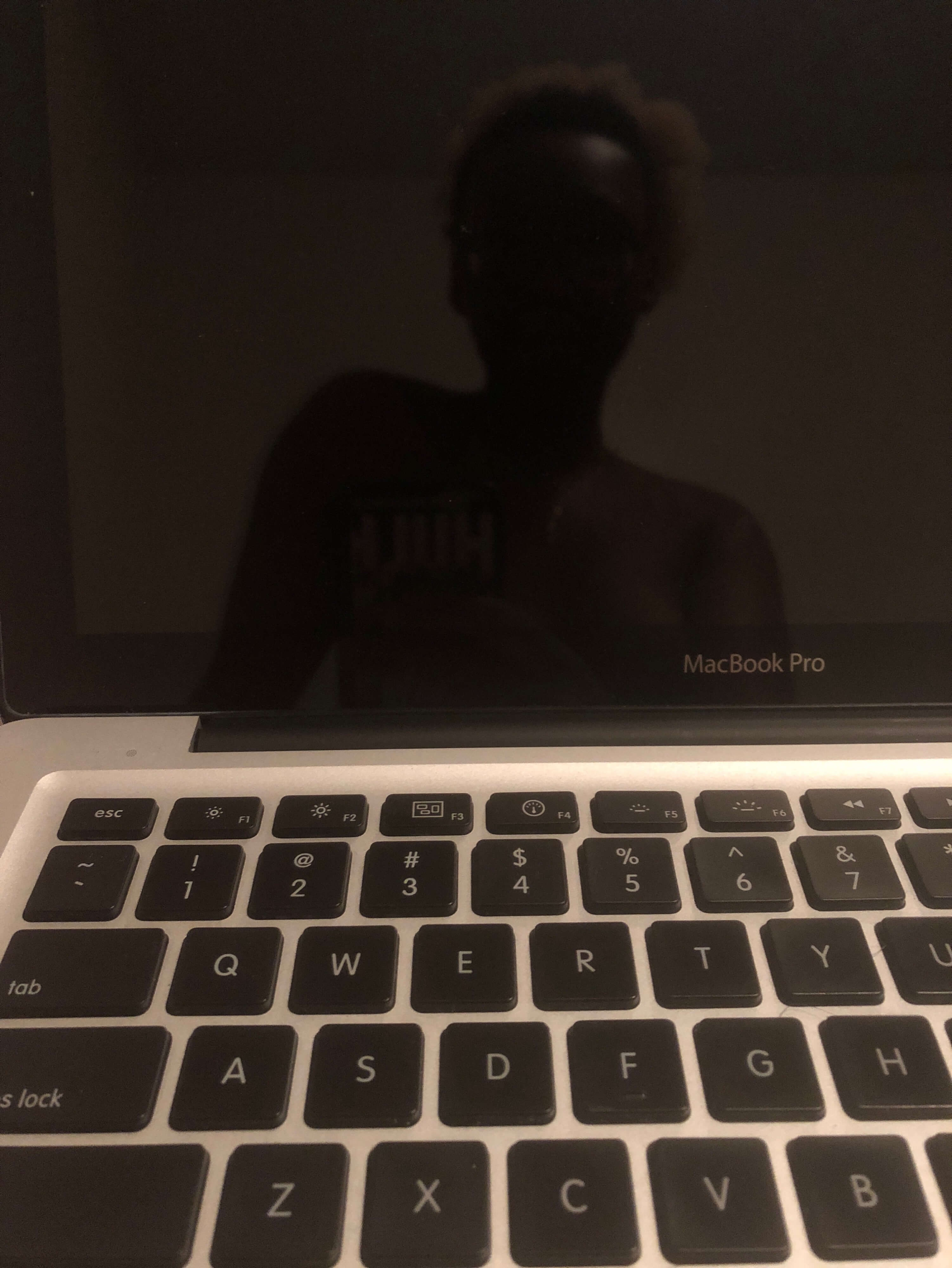 Cara's reflection on a computer screen in Anonymous Writer